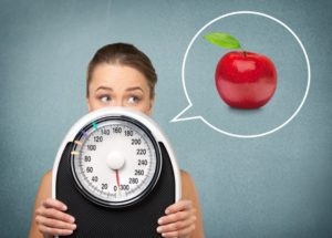 hcg-diet-woman-with-scale